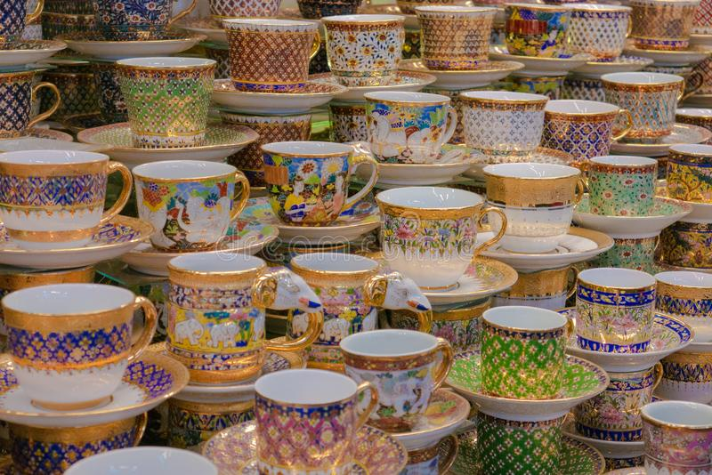 Thai pocelain tea cups for sale at the market in Thailand. Thai pocelain tea cups for sale at the market in Bangkok, Thailand royalty free stock image