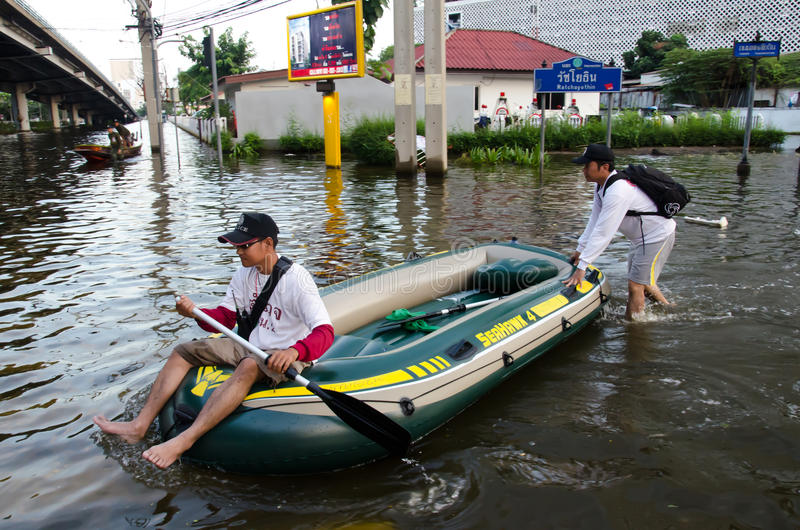 Thai police to act as a water police. BANGKOK THAILAND – NOVEMBER 13: Thai police to act as a water police area at Phahon Yothin Road during the massive stock photo