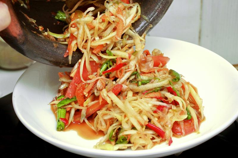 Thai popular recipe, Spicy and sour mixed vegetable salad with p. Thai popular food call Som Tum in Thai ,Spicy and sour mixed vegetable salad with papaya roll royalty free stock photos