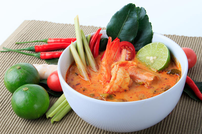Thai Prawn Soup with Lemongrass (Tom Yum Goong) On Brown Cloth Background. stock photos