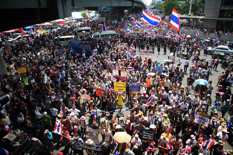 Thai protester anti-government rally. BANGKOK, THAILAND - MARCH 29, 2014: Unidentified protesters hold an anti-government rally and gather together at street stock photography
