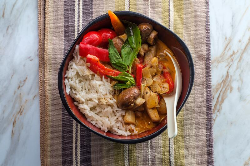 Thai Red Chicken Curry. Thai food spicy coconut milk red curry soup with chicken and rice royalty free stock photography