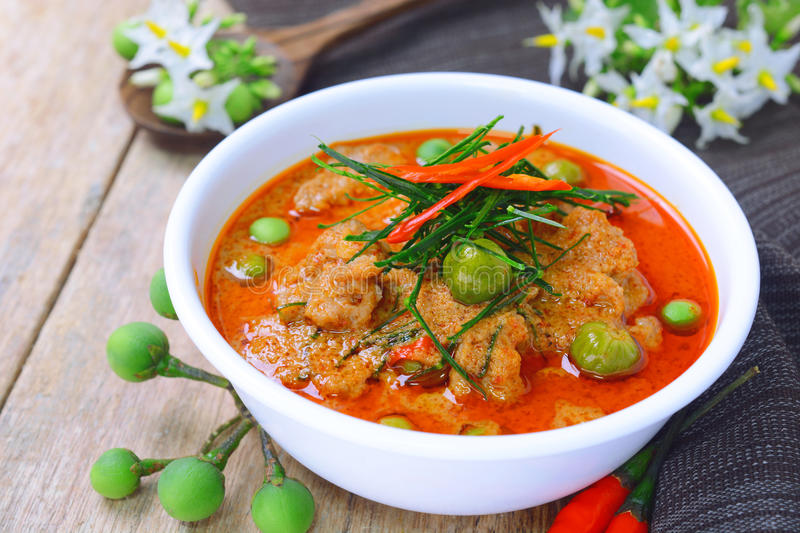 Thai red curry fried with pork and coconut milk (panaeng) royalty free stock photos
