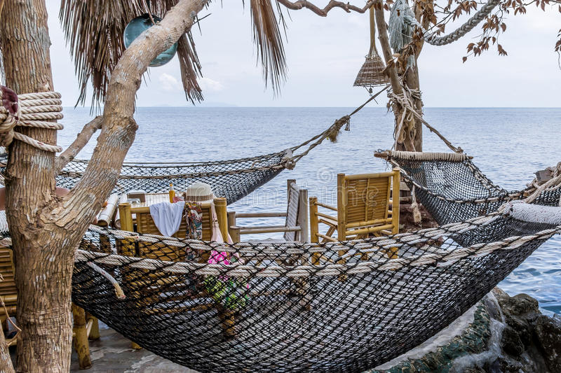 Thai Restaurant with hammocks on a cliff over the ocean stock images