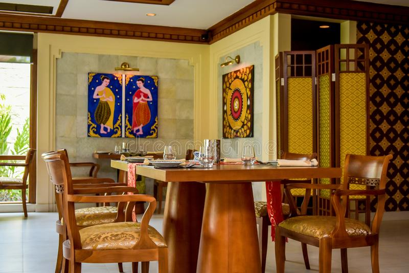 Thai restaurant interior with tables and chairs at resort stock images