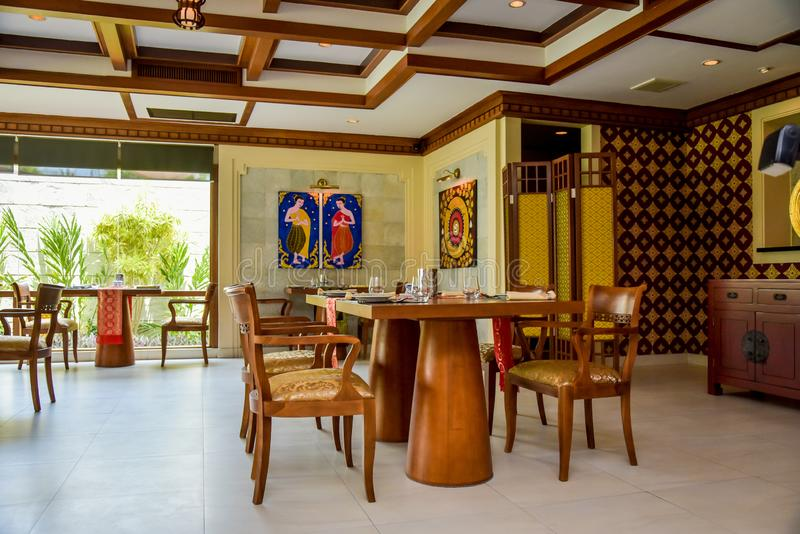 Thai restaurant interior with tables, chairs and shisha at resort stock images