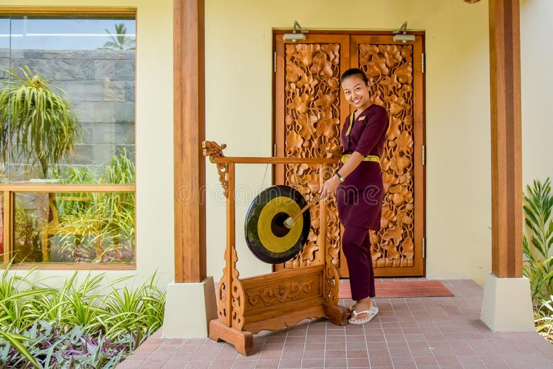 Thai restaurant waitress using the gong wit a smile stock photography