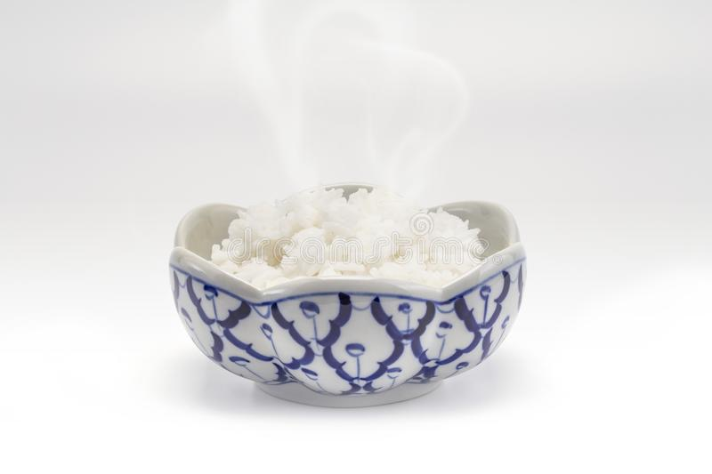 A Thai rice steam in a traditional blue porcelain bowl stock image