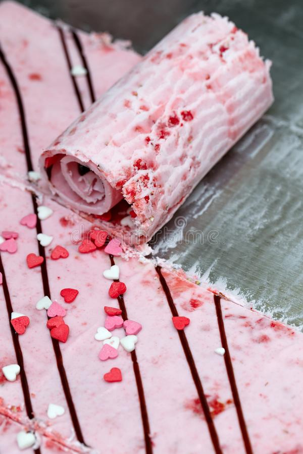 Thai roll ice cream is made by hand on the freezer. Sweet dessert made from natural berries and ingredients. The process. Of making food royalty free stock photos