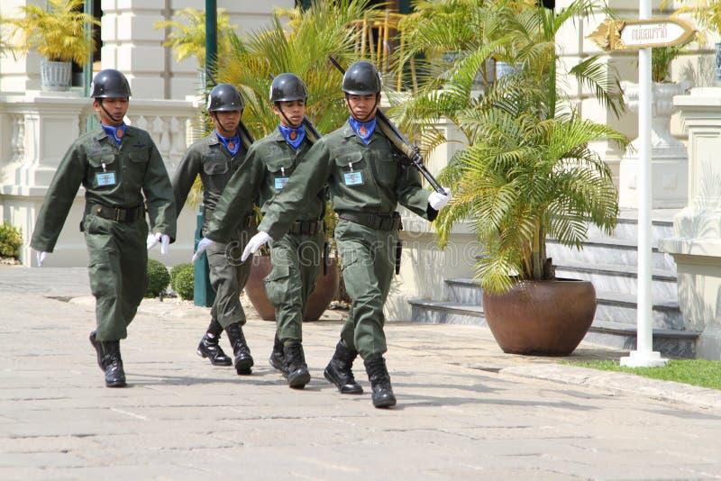 Thai Royal Guards Marching in the Royal Grand Palace, Bangkok. royalty free stock photography