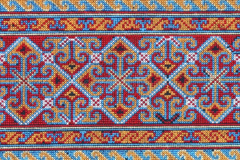 Thai's Cross stitch embroidery on canvas. stock photos