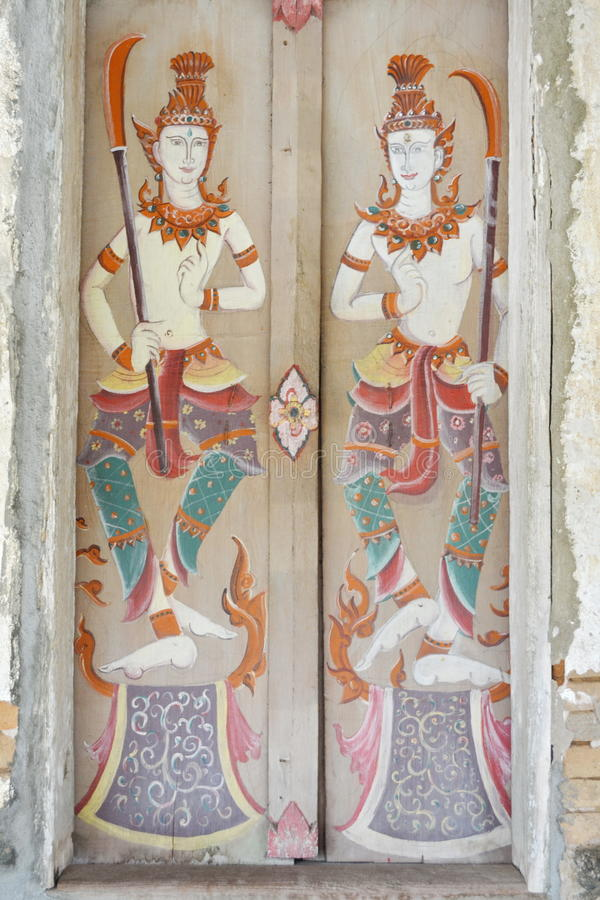 Thai`s painted on the door.Wat Si Po Chai,Na Haeo District,Loei Province,Thailand. Wat Si Po Chai is locatedeven closer to the border country with Laos close to stock images