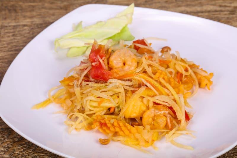 Thai salad with papaya and prawn stock image