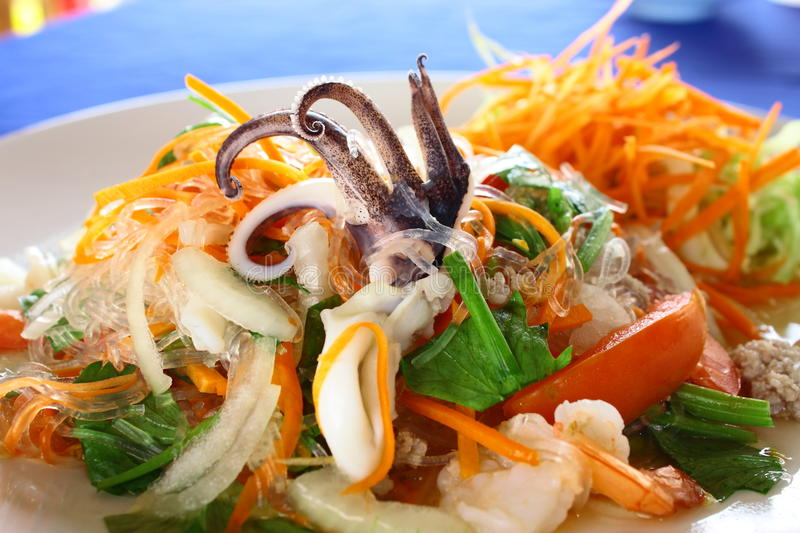 Thai salad by seafood and soft noodle royalty free stock images