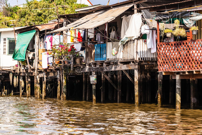Thai shack. Wooden slums on stilts on the riverside of Chao Praya River in Bangkok, Thailand royalty free stock images