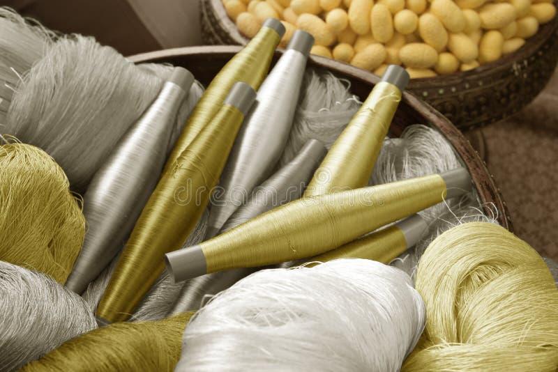 Thai silk pattern, design, texture, thread, cocoon, tool and equipment. Close up the thai silk pattern, design, texture, thread, cocoon, tool and equipment stock photos