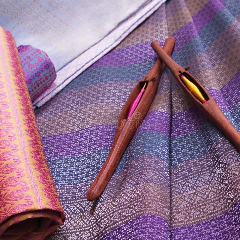 Thai silk pattern, design, texture, thread, cocoon, tool and equipment. Close up the thai silk pattern, design, texture, thread, cocoon, tool and equipment stock image
