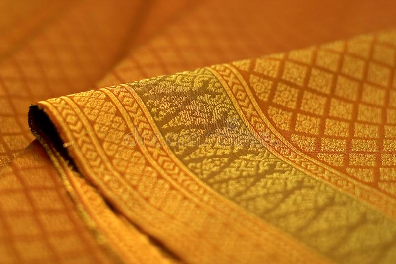 Thai silk pattern, design, texture, thread, cocoon, tool and equipment. Close up the thai silk pattern, design, texture, thread, cocoon, tool and equipment royalty free stock photography