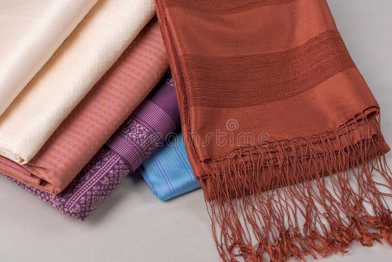 Thai silk pattern, design, texture, thread, cocoon, tool and equipment. Close up the thai silk pattern, design, texture, thread, cocoon, tool and equipment royalty free stock images