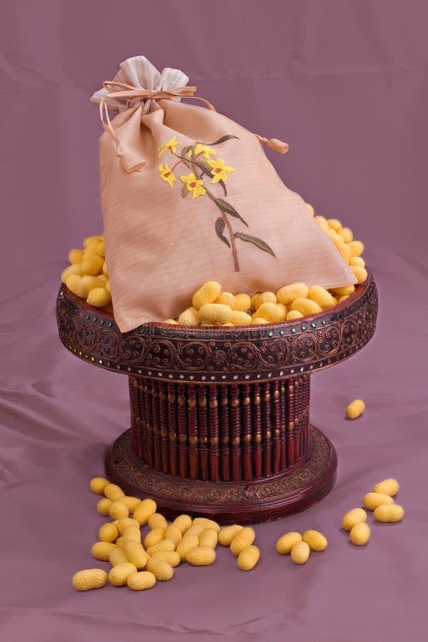 Thai silk pattern, design, texture, thread, cocoon, tool and equipment. Close up the thai silk pattern, design, texture, thread, cocoon, tool and equipment royalty free stock photos