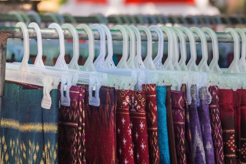 thai silk skirt on hanger royalty free stock photo