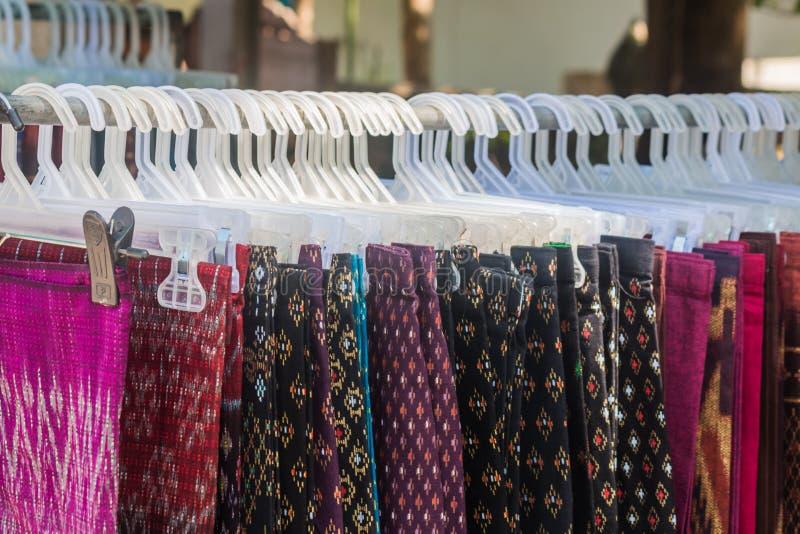 thai silk skirt on hanger stock image