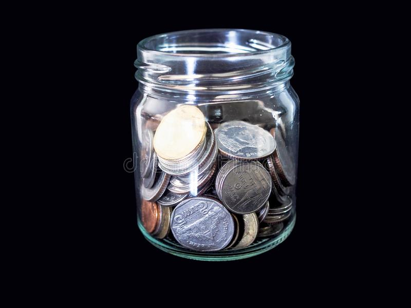 Thai silver coins in glass bottles Collecting money for investment in the future. stock image