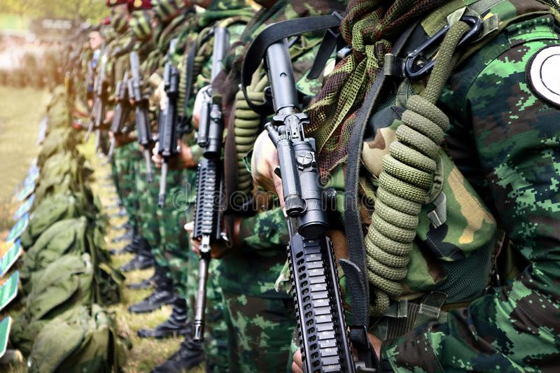 Thai soldiers stand in row.commando soldiers in camouflage uniforms gun in hand stock photo
