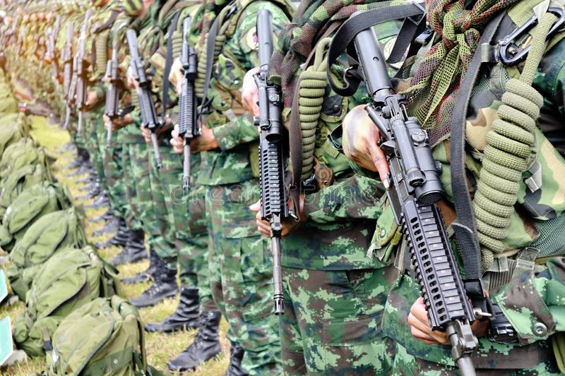 Thai soldiers stand in row.commando soldiers in camouflage uniforms gun in hand stock photography