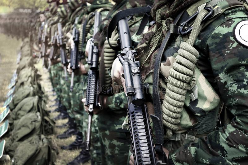 Thai soldiers stand in row.commando soldiers in camouflage uniforms gun in hand stock image