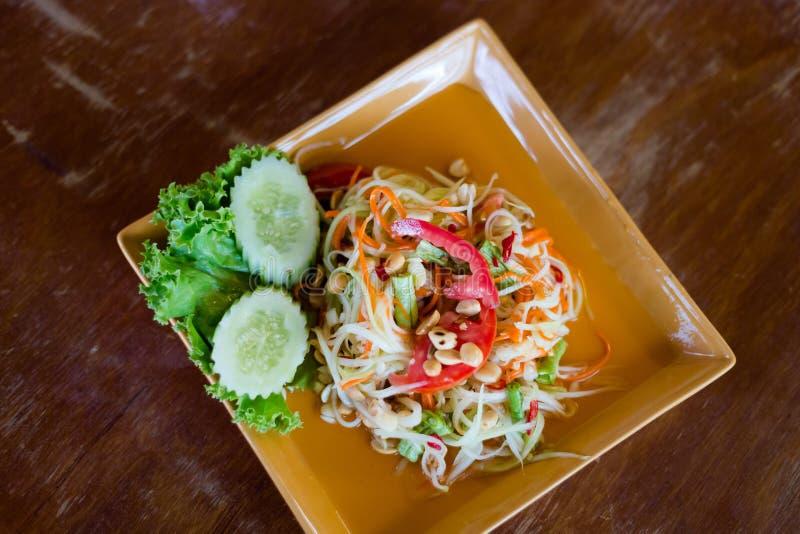 Thai Som Tam papaya salad. Fresh prepared asian spicy Som Tam papaya salad in local restaurant on Koh Lanta island. Traditional thai cuisine made of fresh royalty free stock image