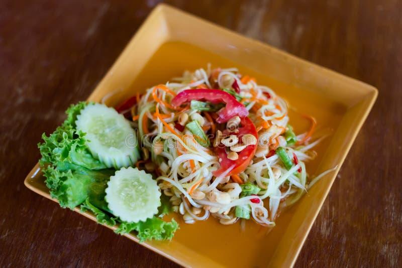 Thai Som Tam papaya salad. Fresh prepared asian spicy Som Tam papaya salad in local restaurant on Koh Lanta island. Traditional thai cuisine made of fresh royalty free stock photography