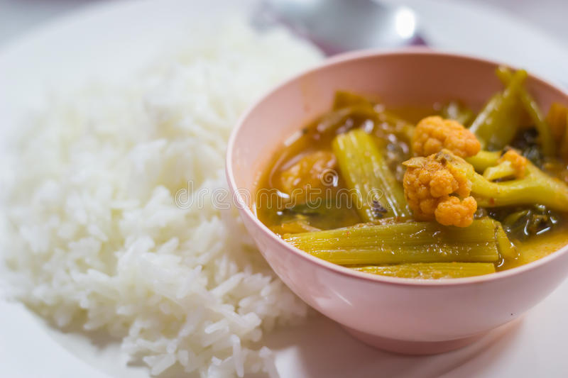 Thai sour soup. Hot and sour, fish and vegetable ragout with rice stock images
