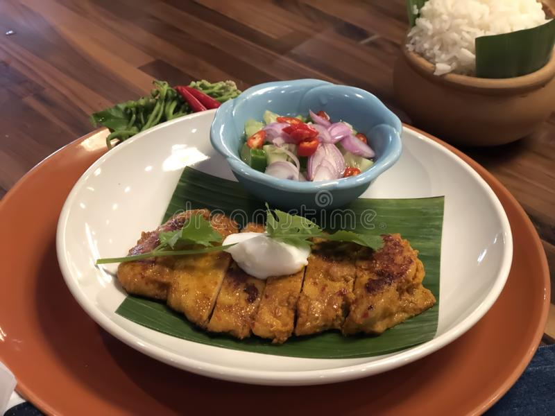 Thai Southern Style Grilled chicken with sauce and stream rice stock image