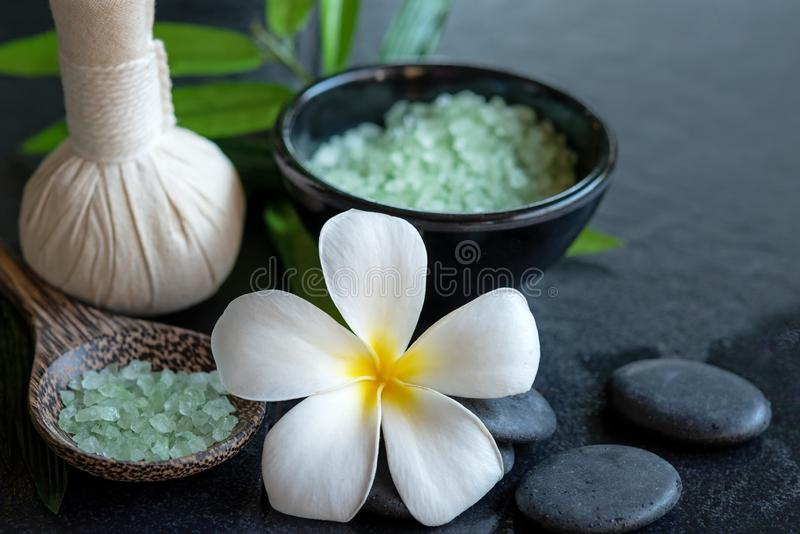 Thai spa composition treatments aroma therapy with candles and Plumeria flowers on wooden table close up. Healthy Concept stock photography