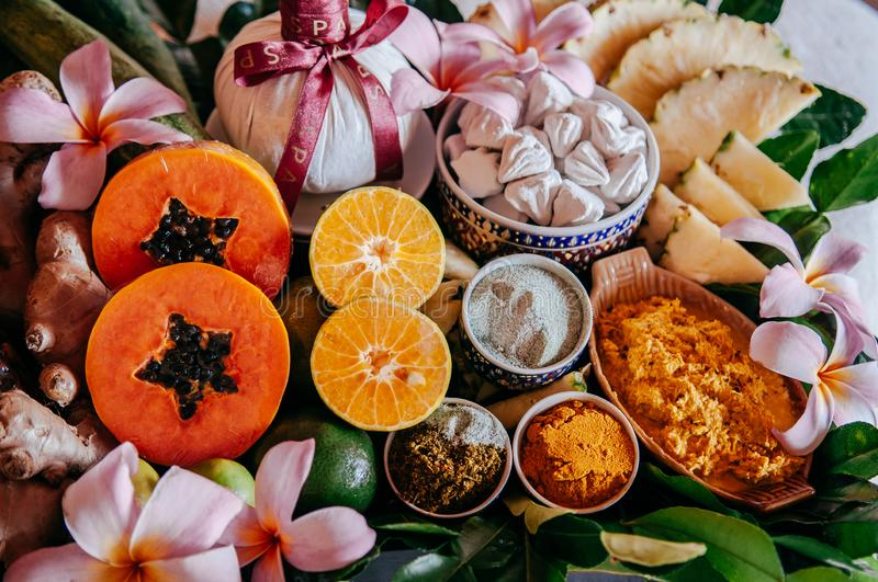 Thai spa ingredients with herbs and fresh tropical fruits stock photo