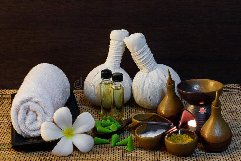 Thai spa massage setting on candlelight stock photos
