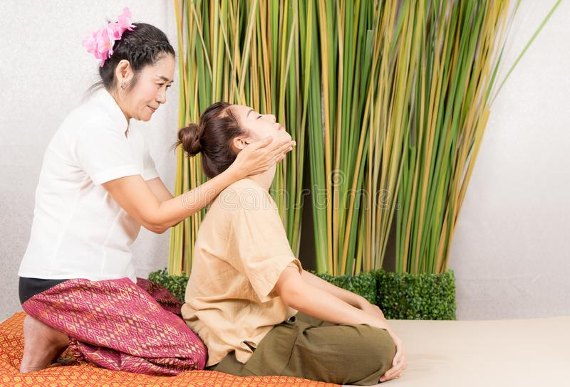 Spa Massage therapist is stretching women neck stock images