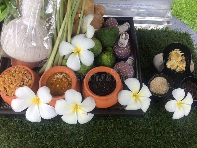 Thai spa procedures, flowers, pots, incense. Preparing for a Thai massage stock image