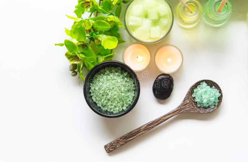 Thai Spa Treatments aroma therapy salt and nature green sugar scrub and rock massage with green orchid flower on wooden white wit. H candle. Thailand. Healthy stock photography