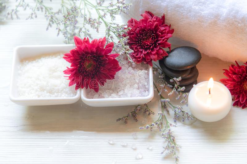 Thai Spa Treatments aroma therapy salt and sugar scrub and rock massage with red flower with candle for relax time. royalty free stock photography