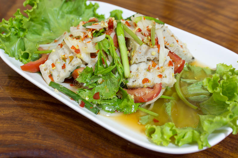 Thai spicy food. Spicy Salad of Boiled Pork Sausage , Thai style food royalty free stock photo