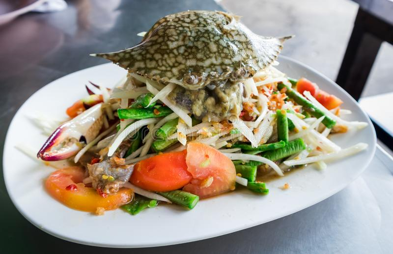 Thai Spicy papaya salad with raw blue crab stock photos