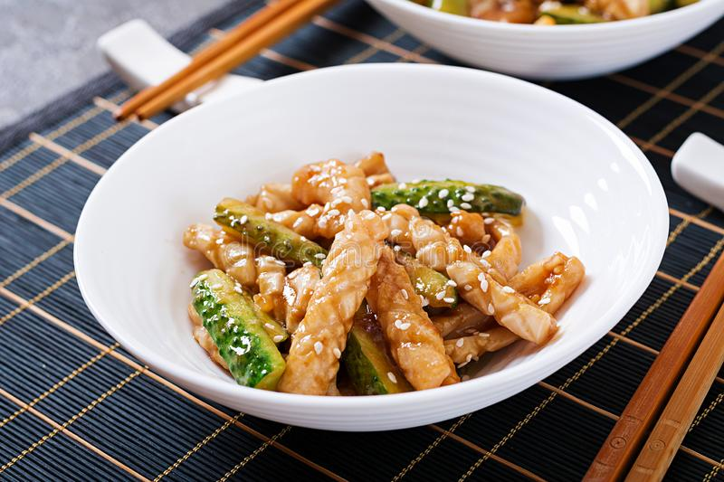 Thai spicy salad with squid and cucumber in sweet and sour sauce. Asian food stock photography