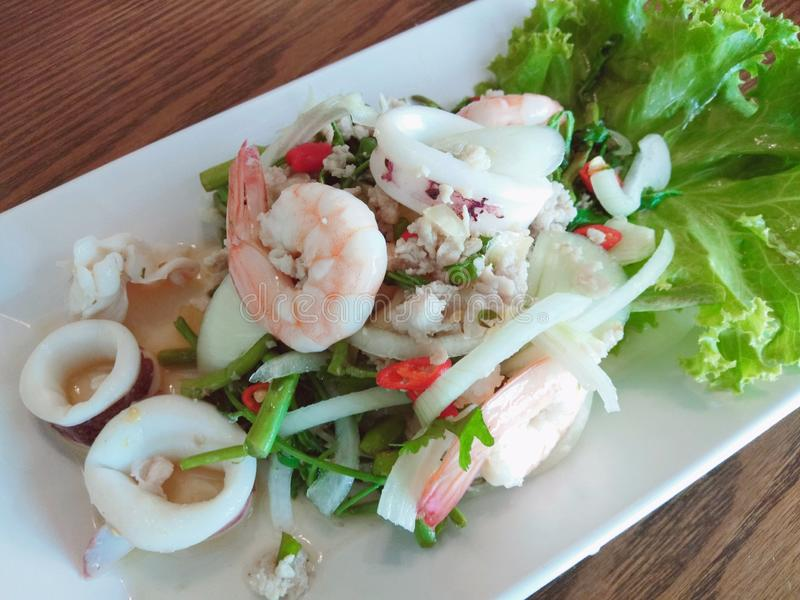 Thai spicy seafood salad with water mimosa. Thaifood, fooddrink, cleanfood stock image