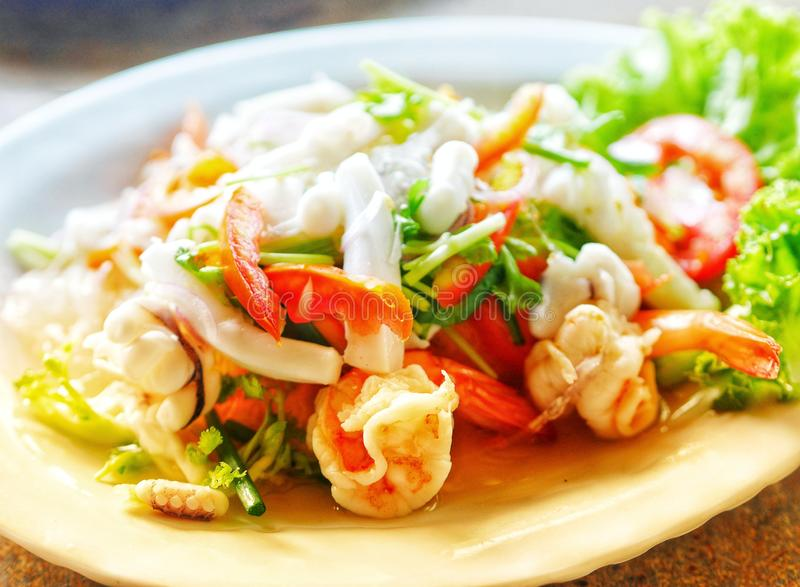 Thai Spicy Seafood Salad Yum Talay. Tomato vegetable organic restaurant royalty free stock photography