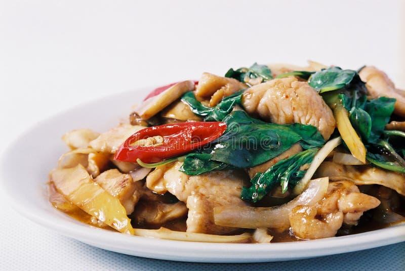Thai stir fried Basil. Stir fried chicken with thai basil, onion. chilli royalty free stock photo