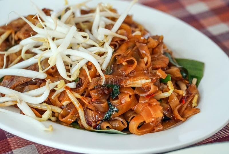 Thai stir fried noodle with pork. Thai traditional stir fried noodle with pork royalty free stock photos