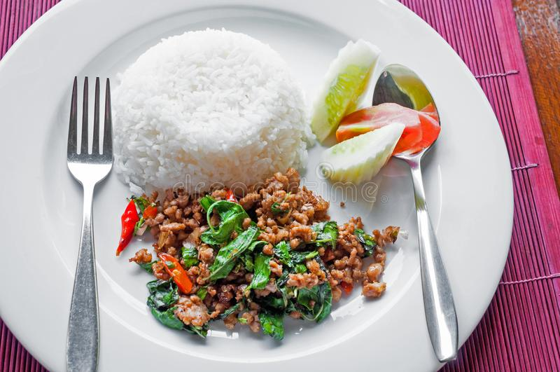 Thai stir-fried pork and basil served with rice. A Thai stir-fried pork and basil served with rice royalty free stock photos