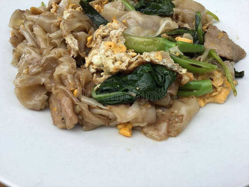 Pad See Ew. Thai stir fried rice noodle with soy sauce, chinese broccoli, eggs, and pork royalty free stock photos